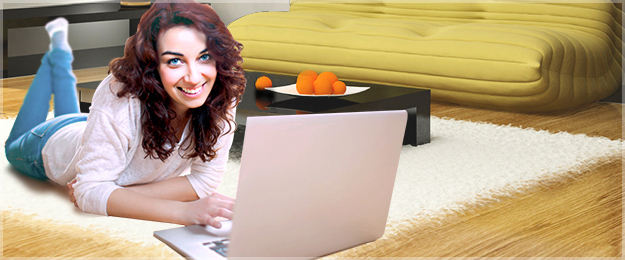 woman with laptop on rug