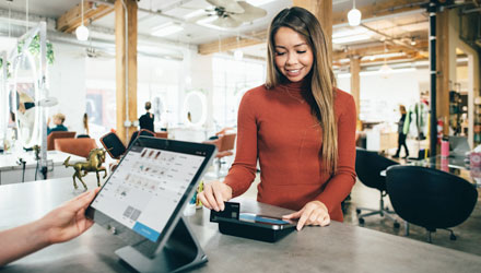 young woman making a purchase at the cashiers desk