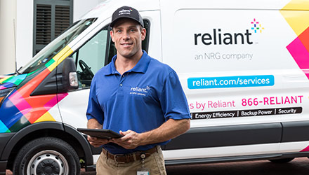 Reliant Technician in front of Reliant van